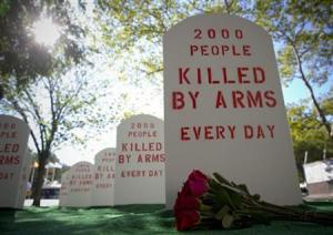 Campaigners for the Control Arms coalition set up a mock graveyard next to the United Nations building in New York