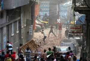Anti-Mursi protesters and residents of an area in Sidi Gaber, clash in a side street off a main street where a massive anti-Mursi protest is taking place, in Alexandria