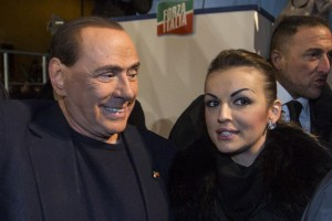 Berlusconi with his fiancée at his rally after he has been expelled from the Senate. Credits to La Repubblica.