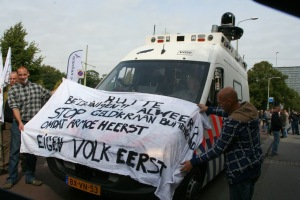 "Neo-Nazis at a PVV demonstration in the Netherlands. The last line on the banner says ""Own people first""."