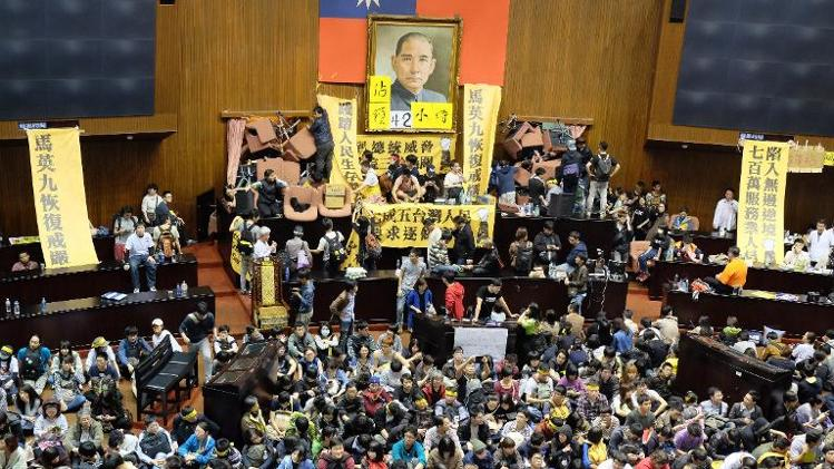 Photo Credits: News Yahoo. Demonstrators occupying the Taiwanese Parliament.