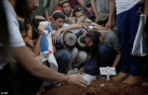 Photo credits: AP Mourning for the death of the three Israeli teenagers.